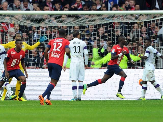 Lille's Pape Souare celebrates after scoring the opening goal against Toulouse on November 24, 2013