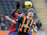 Paul McShane of Hull City tackled by Yannick Bolasie of Crystal Palace during the Barclays Premier League match between Hull City and Crystal Palace at KC Stadium on November 23, 2013