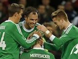 Germany's Per Mertesacker is congratulated by teammates after scoring the opening goal against England during their international friendly match on November 19, 2013