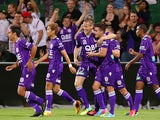 Michael Thwaite and Jamie Maclaren of the Glory celebrate a goal during the round seven A-League match between Perth Glory and the Central Coast Mariners at nib Stadium on November 23, 2013
