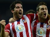 Atletico Madrid's Raul Garcia celebrates with Koke after scoring during the Spanish League football match against Getafe on November 23, 2013