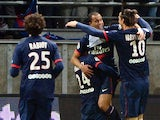 Paris Saint-Germain's Brazilian forward Lucas Moura is congratulated by his teammates after scoring a goal during the French Football match Reims vs Paris Saint-Germain, on November 23, 2013