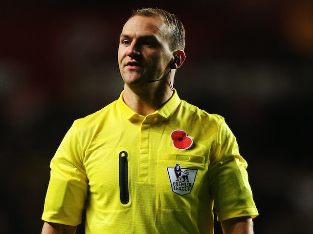 Match referee Robert Madley looks on during the Barclays Premier League match between Swansea City and Stoke City at Liberty Stadium on November 10, 2013