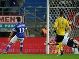 Bastia's Franco Algerian midfielder Ryad Boudebouz scores a goal past Sochaux goalkeeper Simon Pouplin on November 23, 2013