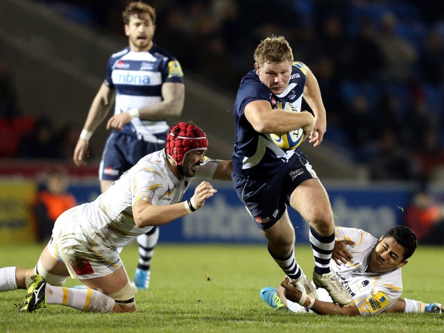 Dan Braid of Sale Sharks breaks through the tackle of Jonathan Thomas of Worcester Warriors during the Aviva Premiership match between Sale Sharks and Worcester Warriors at the A J Bell Stadium, on November 22, 2013
