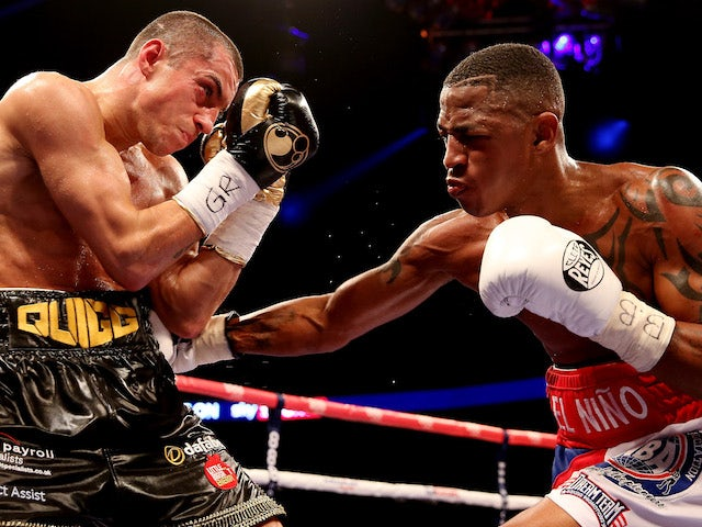 Scott Quigg in action with Yoandris Salinas during their WBA World Super Bantamweight Championship bout at O2 Arena on October 5, 2013