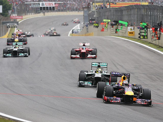 Sebastian Vettel leads from Nico Rosberg during the Brazilian Grand Prix at Interlagos on November 24, 2013