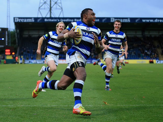Bath's Semesa Rokoduguni runs in to score a try against London Wasps during their Aviva Premiership match on November 24, 2013