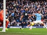 Man City's Sergio Aguero scores his team's third goal against Tottenham on November 24, 2013