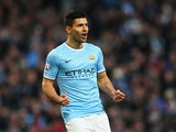 Man City's Sergio Aguero celebrates after scoring his team's fourth goal and his second of the match against Tottenham on November 24, 2013