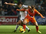 Stevanovic of Elche competes for the ball with Fede of Valencia during the La Liga match between Elche FC and Valencia CF at Manuel Martinez Valero on November 24, 2013