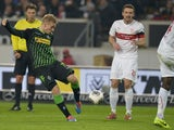 Moenchengladbach's Swedish defender Oscar Wendt scores his team's second goal past Stuttgart's midfielder Christian Gentner and defender Antonio Ruediger during the German first division Bundesliga football match between VfB Stuttgart and Borussia Moenche
