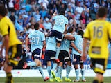 Sydney FC celebrate a goal by Richard Garcia during the round seven A-League match between Sydney FC and the Wellington Phoenix at Allianz Stadium on November 23, 2013