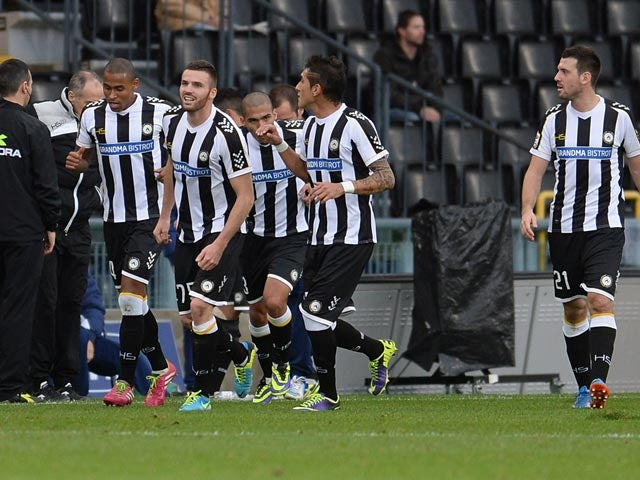 Udinese's Thomas Heurtaux is congratulated by teammates after scoring the opening goal against Fiorentina on November 24, 2013