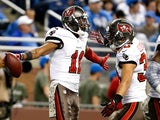 Tiquan Underwood of the Tampa Bay Buccaneers celebrates a touchdown catch in the fourth quarter with Brian Leonard at Ford Field on November 24, 2013