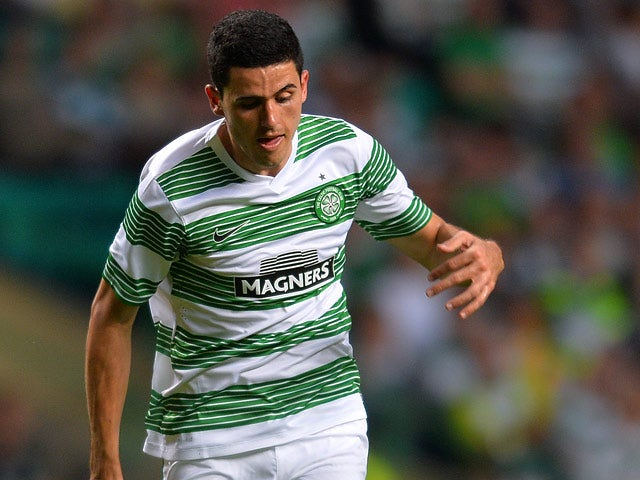 Celtic's Tomas Rogic in action against Cliftonville during their Champions League second qualifying round second leg match on July 23, 2013