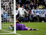 Yoan Gouffran of Newcastle United scores the second goal past Norwich keeper John Ruddy during the Barclays Premier League match on November 23, 2013