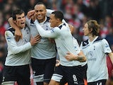 Younes Kaboul celebrates his winning goal for Tottenham Hotspur against Arsenal on November 20, 2010.