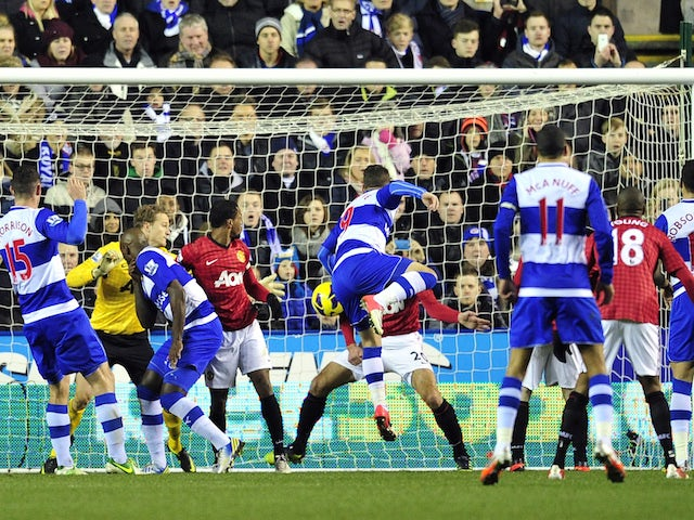 Reading's English striker Adam Le Fondre scores their second goal during the English Premier League football match between Reading and Manchester United on December 1, 2012