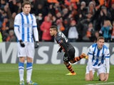 Shakhtar's Alex Teixeira celebrates after scoring his team's second goal against Real Sociedad during their Champions League group match on November 27, 2013