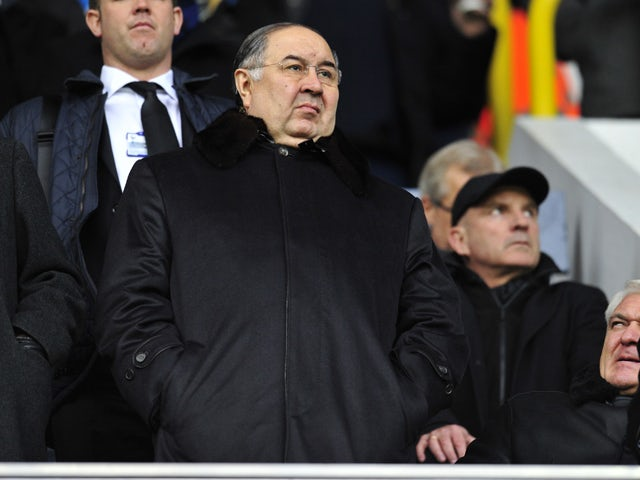 Arsenal's Russian shareholder Alisher Usmanov looks on before the English Premier League football match between Tottenham Hotspur and Arsenal at White Hart Lane in north London on March 3, 2013