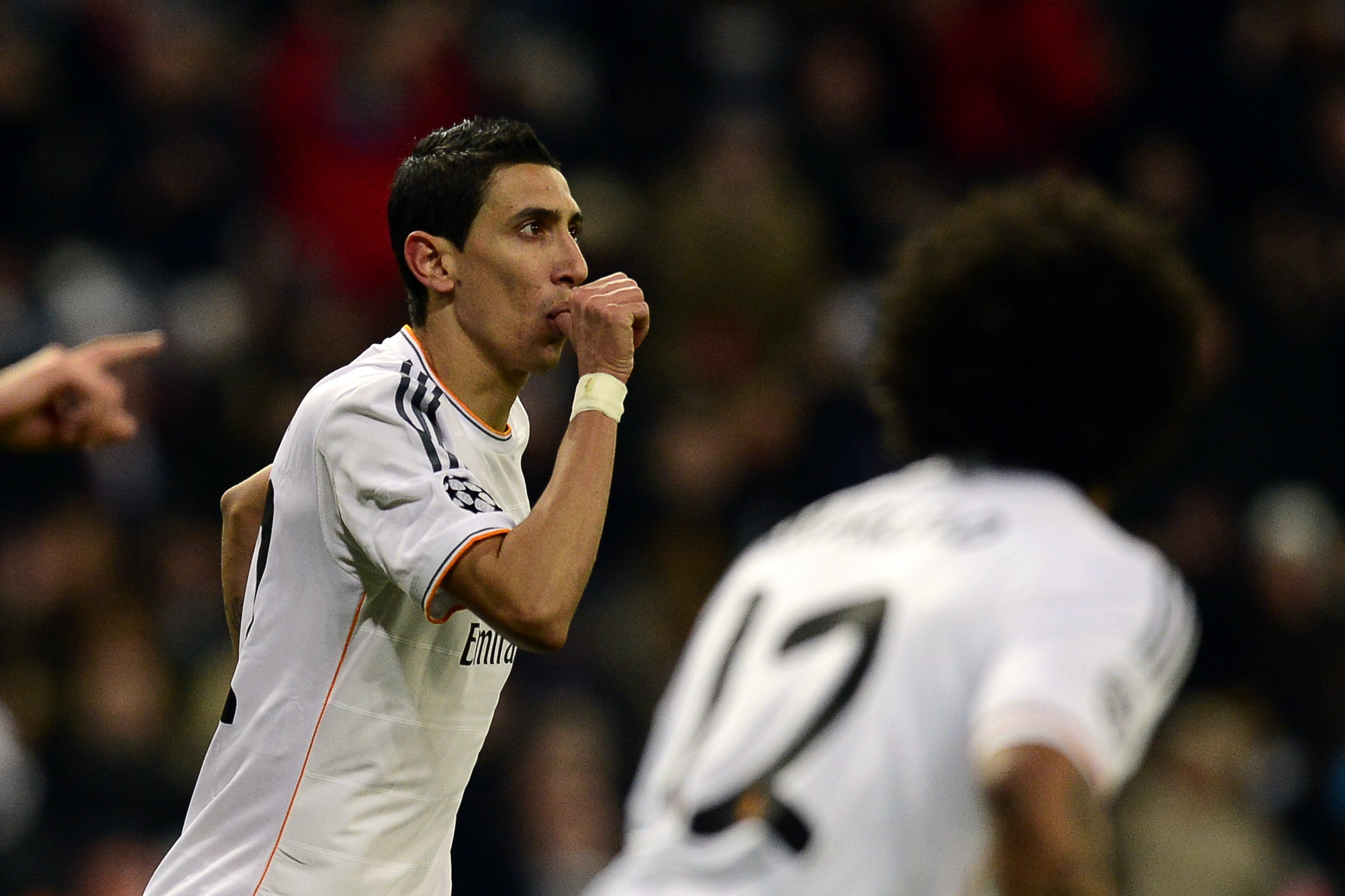 Real Madrid' Angel di Maria celebrates after scoring his team's third goal against Galatasaray during their Champions League group match on November 27, 2013