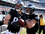 Zach Ertz #86 of the Philadelphia Eagles celebrates his touchdown with teammate James Casey #85 in the first quarter against the Arizona Cardinals on December 1, 2013