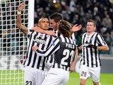 Juventus' Arturo Vidal is congratulated by teammates after scoring the opening goal against Copenhagen during their Champions League group match on November 27, 2013