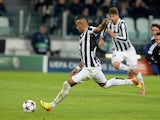 Juventus' Arturo Vidal scores his team's second goal via the penalty spot against Copenhagen during their Champions League group match on November 27, 2013