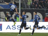 Davide Brivio of Atalanta BC celebrates after scoring the opening goal during the Serie A match between Atalanta BC and AS Roma at Stadio Atleti Azzurri d'Italia on December 1, 2013