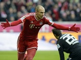 Bayern Munich's Dutch midfielder Arjen Robben celebrates the first goal for Munich beside of Portuguese Iranian goalkeeper Daniel Davari during the German first division Bundesliga football match Bayern Muenchen vs Eintracht Braunschweig in Munich on Nove