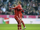 Bayern Munich's Dutch midfielder Arjen Robben and Bayern Munich's midfielder Toni Kroos celebrate the second goal during the German first division Bundesliga football match Bayern Munchen vs Eintracht Braunschweig in Munich on November 30, 2013