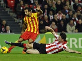 Athletic Bilbao's French defender Aymeric Laporte tackles Barcelona's defender Martin Montoya during the Spanish league football match Athletic Club Bilbao vs FC Barcelona at the San Mames stadium in Bilbao on December 1, 2013