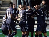 Bordeaux's players celebrate after scoring a goal during the French L1 football match between Bordeaux and Ajaccio, on December 1, 2013