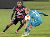 Bordeaux's Nicolas Maurice-Belay and Frankfurt's Sebastian Rode battle for the ball during their Europa League group match on November 28, 2013