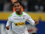 Moenchengladbach's Brazilian midfielder Raffael celebrates scoring the 1-0 during the German first division Bundesliga football match Borussia Moenchengladbach vs SC Freiburg in the German city of Moenchengladbach on December 1, 2013