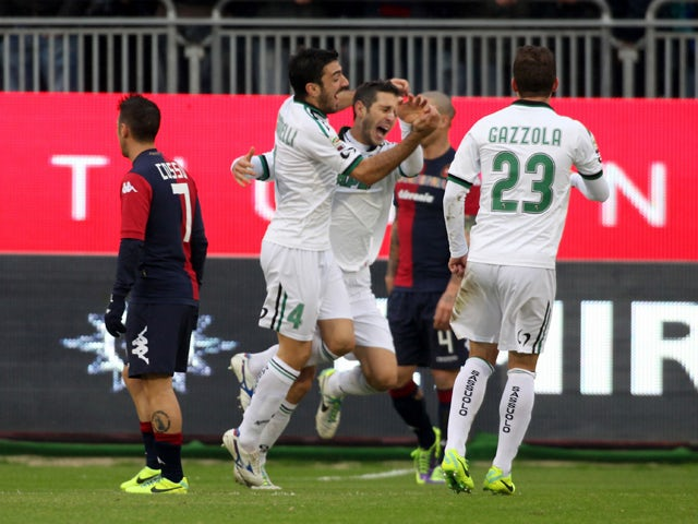 Marzoratti Lino of Sassuolo celebrates with team-mates after scoring a goal during the Serie A match between Cagliari Calcio and US Sassuolo Calcio at Stadio Sant'Elia on December 1, 2013