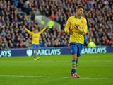 Aaron Ramsey of Arsenal doesn't celebrate scoring their first goal in respect for Cardiff his old team during the Barclays Premier League match between Cardiff City and Arsenal at Cardiff City Stadium on November 30, 2013