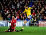 athieu Flamini of Arsenal beats Steven Caulker of Cardiff City as he scores their second goal during the Barclays Premier League match between Cardiff City and Arsenal at Cardiff City Stadium on November 30, 2013