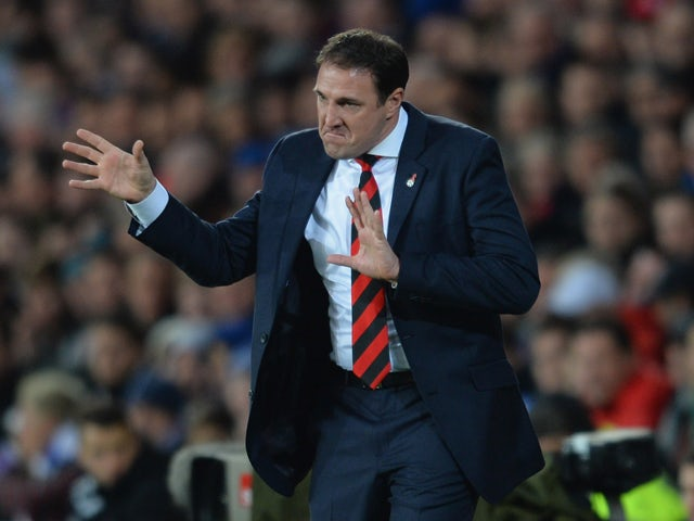 Manager Malky Mackay of Cardiff shouts orders to his players during the Barclays Premier League match between Cardiff City and Arsenal at Cardiff City Stadium on November 30, 2013