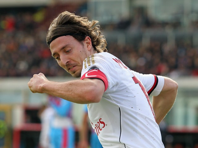 Riccardo Montolivo of Milan celebrates after scoring his team's equalizing goal during the Serie A match between Calcio Catania and AC Milan at Stadio Angelo Massimino on December 1, 2013