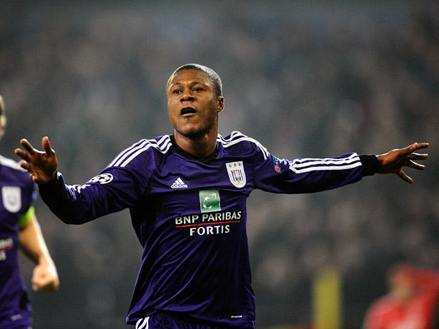 Anderlecht's Chancel Mbemba celebrates after scoring the opening goal against Benfica during their Champions League group match on November 27, 2013