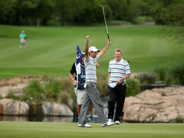 Charl Schwartzel of South Africa celebrates winning the Alfred Dunhill Championship on a score of -17 under par at Leopard Creek Country Club on December 1, 2013