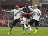 Charles N'Zogbia of Aston Villa is challenged by Giorgos Karagounis and Eyong Enoh of Fulham during the Barclays Premier League match between Aston Villa and Fulham at Villa Park on April 13, 2013