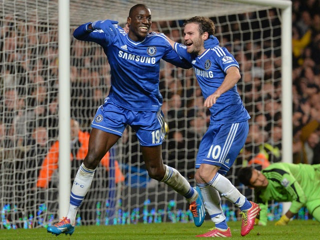 Chelsea's French-born Senegalese striker Demba Ba celebrates with Chelsea's Spanish midfielder Juan Mata after Ba scored Chelsea's third goal during the English Premier League football match between Chelsea and Southampton at Stamford Bridge in London, on