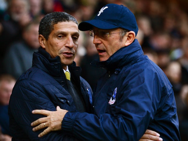 Chris Hughton the Norwich manager greets Tony Pulis the Crystal Palace manager prior to kickoff during the Barclays Premier league match between their two sides on November 30, 2013