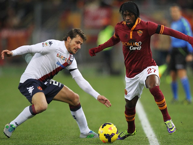 Daniele Dessena of Cagliari competes for the ball with Gervinho of AS Roma during the Serie A match between AS Roma and Cagliari Calcio at Stadio Olimpico on November 25, 2013
