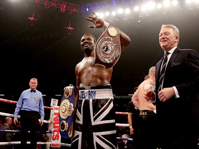 Dereck Chisora celebrates his victory over Ondrej Pala during their WBO and Vacant International Heavyweight Championship bout at The Copper Box on November 30, 2013