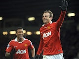 Dimitar Berbatov celebrates scoring his fifth goal against Blackburn Rovers on November 25, 2010.