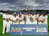 Durham captain Paul Collingwood and team celebrate with the trophy after winning the LV County Championship Division One title after day three of the LV County Championship Division One match between Durham and Nottinghamshire at The Riverside on Septembe